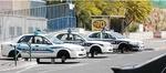 Police cars on blocks